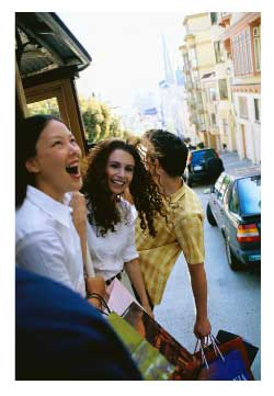 women riding a cable car in san francisco