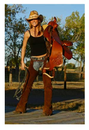 cowgirl with saddle and chaps