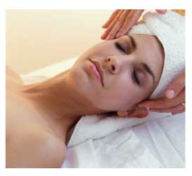 woman receiving a facial or craniosacral massage