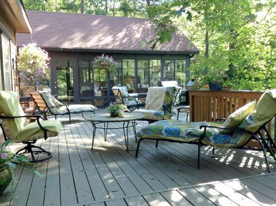 Expansive deck and garden by the pond