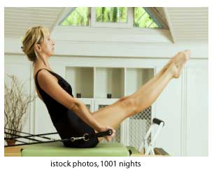 woman doing core-strengthening Pilates exercise