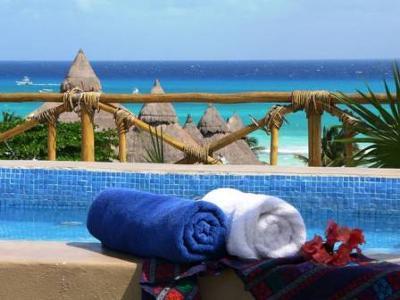 Blue Pearl Suites solarium with ocean view and dip pool