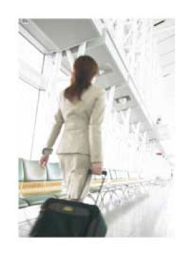 woman pulling a rolling suitcase through the airport
