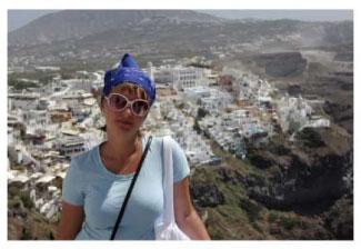 a woman tourist on a mountainto