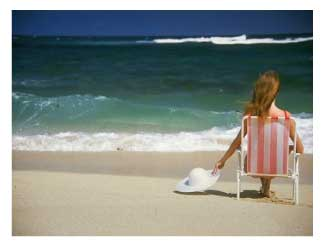 woman relaxing in a chair on a beach vacation