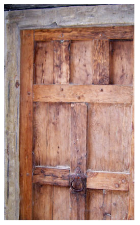 a lovely, historic wooden door from Mission San Jose in San Antoni