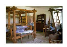 a large, old-fashioned quilting rack