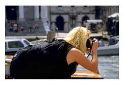 female tourist in Venice, Italy taking a phot